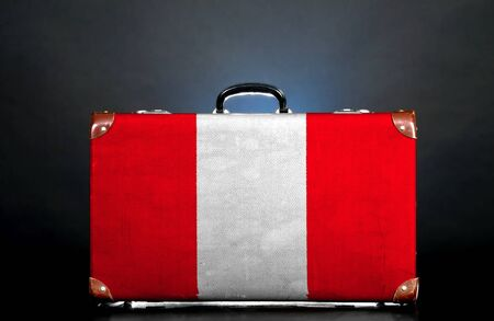 The Peru flag on a suitcase for travel. photo
