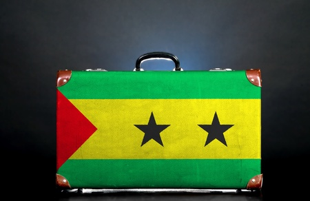 The São Tomé and Príncipe flag on a suitcase for travel. photo