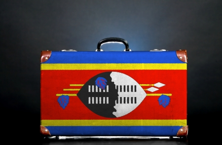The Swaziland flag on a suitcase for travel. photo