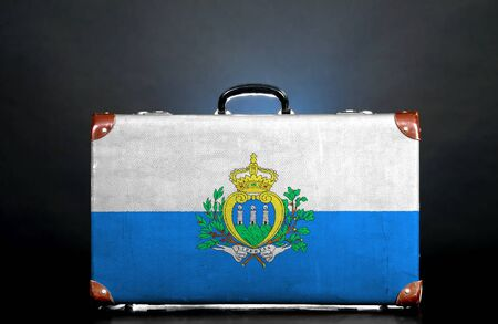 The San Marino flag on a suitcase for travel. photo