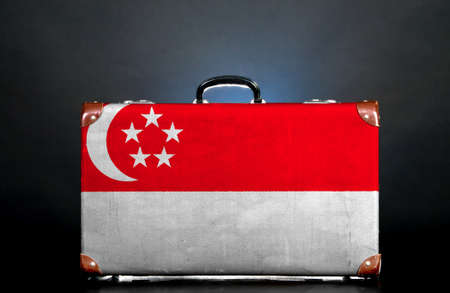 The Singapore flag on a suitcase for travel.