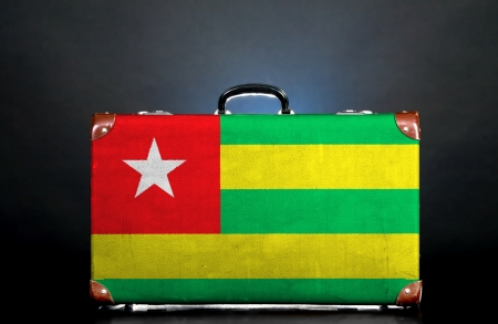 The Togo flag on a suitcase for travel. photo