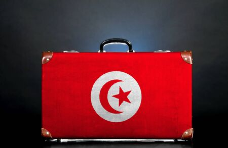 The Tunis flag on a suitcase for travel. Stock Photo - 15436790
