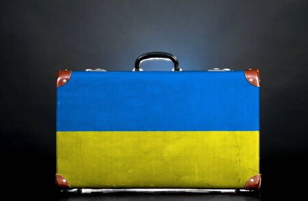 The Ukrainian flag on a suitcase for travel. photo