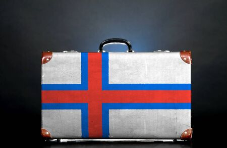 The Faroe Islands flag on a suitcase for travel. photo