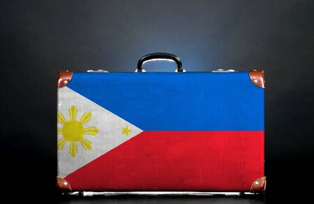 The Philippines flag on a suitcase for travel. photo