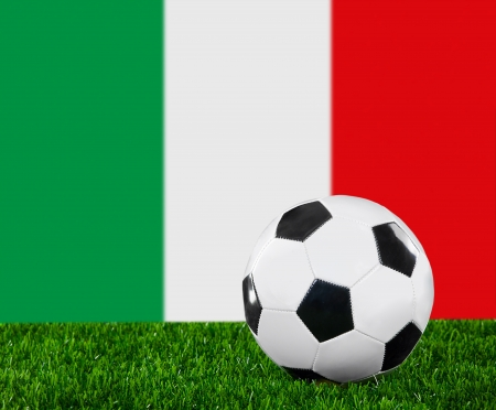 The Italian flag and soccer ball on the green grass. photo