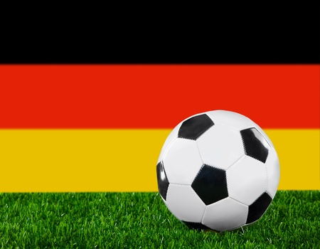 the national team: The German flag and soccer ball on the green grass.