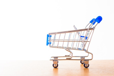 shopping carts on the wooden floor. isolated on white Stock Photo - 15436670