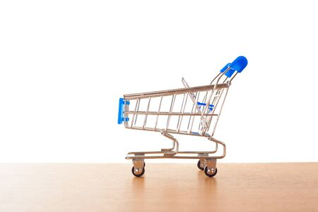 shopping carts on the wooden floor. isolated on white Stock Photo - 15436163