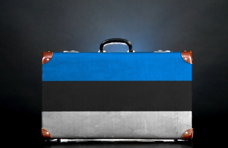 estonian: The Estonian flag on a suitcase for travel.
