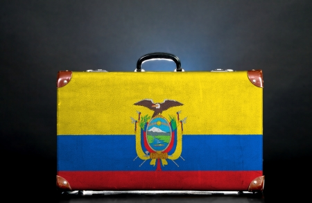 The Ecuador flag on a suitcase for travel. photo