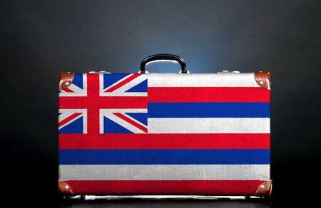 hawaii flag: The Hawaii flag on a suitcase for travel.