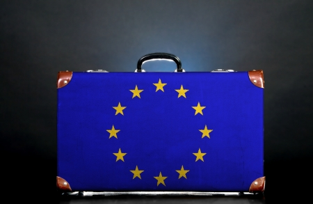 The European Union Flag on a suitcase for travel. photo