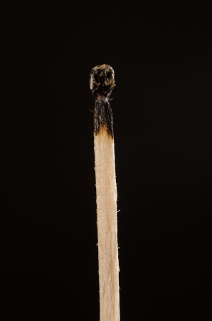 Wooden matches on a black background photo