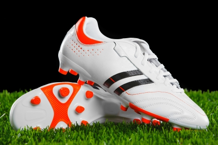 Soccer shoes on the green grass  photo