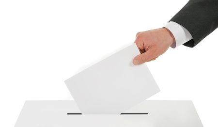 Man hand down the ballot in the ballot box photo