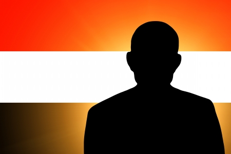 The Yemeni flag and the silhouette of an unknown man Stock Photo - 15943351