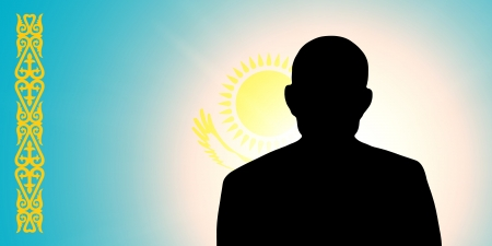 unnamed: The Kazakh flag and the silhouette of an unknown man Stock Photo