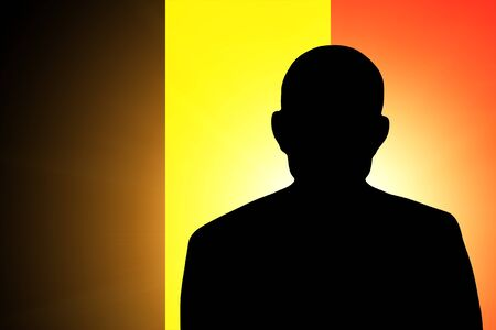 The Belgian flag and the silhouette of an unknown man photo