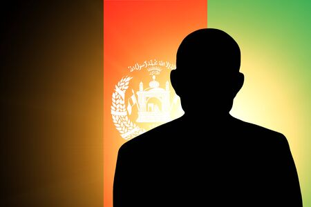 The Afghan flag and the silhouette of an unknown man Stock Photo - 15943501