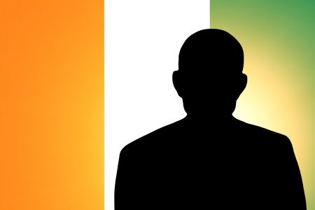 The Republic of Côte dIvoire flag and the silhouette of an unknown man photo