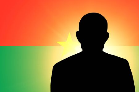 unnamed: The Burkina Faso flag and the silhouette of an unknown man Stock Photo