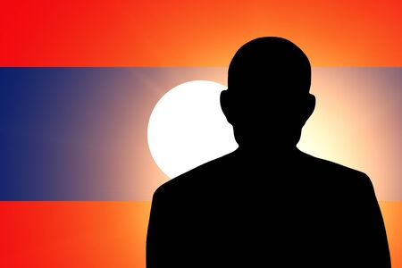 unnamed: The Laotian flag and the silhouette of an unknown man Stock Photo
