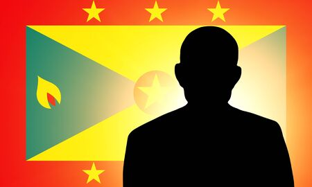 The Grenada flag and the silhouette of an unknown man photo