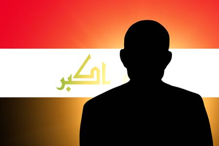 unnamed: The Iraqi flag and the silhouette of an unknown man Stock Photo