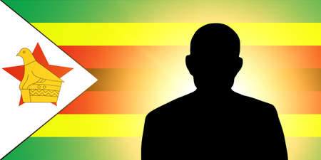 The Zimbabwe flag and the silhouette of an unknown man photo