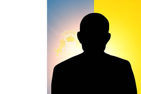 unnamed: The Canary Islands flag and the silhouette of an unknown man and the silhouette of an unknown man Stock Photo