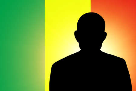 unnamed: The Malian flag and the silhouette of an unknown man Stock Photo