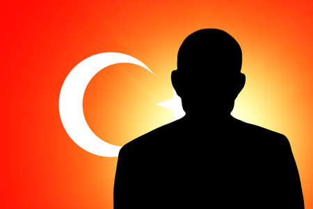 unnamed: The Turkish flag and the silhouette of an unknown man Stock Photo
