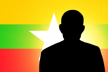 unnamed: The Myanmar flag and the silhouette of an unknown man Stock Photo