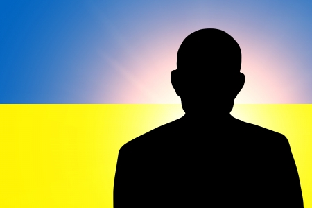ukrainian flag: The Ukrainian flag and the silhouette of an unknown man