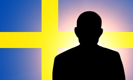 unnamed: The Swedish flag and the silhouette of an unknown man Stock Photo