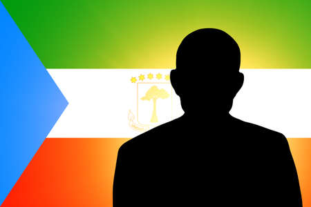 unnamed: The Equatorial Guinea flag and the silhouette of an unknown man Stock Photo