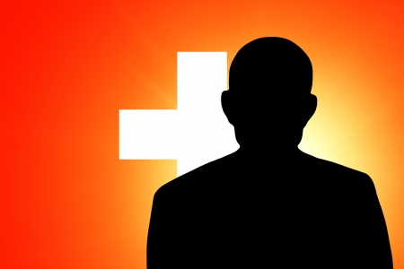 unnamed: The Swiss flag and the silhouette of an unknown man Stock Photo