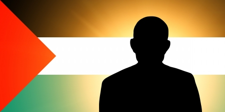 The Palestinian flag and the silhouette of an unknown man Stock Photo - 15943368