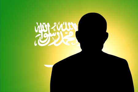 unnamed: The Saudi Arabia flag and the silhouette of an unknown man