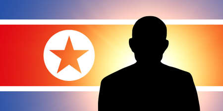 The North Korea flag and the silhouette of an unknown man Stock Photo - 15943463