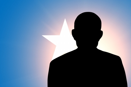 The Somalia flag and the silhouette of an unknown man photo