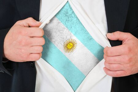 The Argentine flag painted on the chest of a man photo