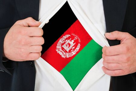 afghan flag: The Afghan flag painted on the chest of a man