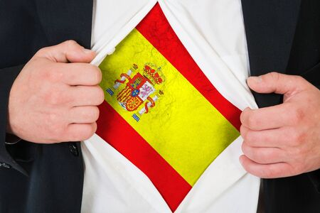 The Spanish flag painted on the chest of a man photo