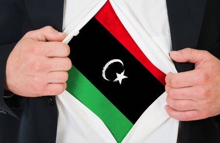 libyan: The Libyan flag painted on the chest of a man