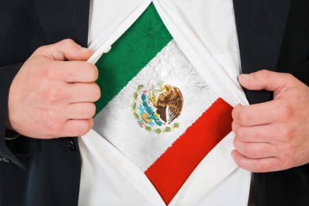 The Mexican flag painted on the chest of a man photo