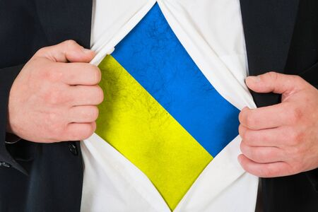 The Ukrainian flag painted on the chest of a man photo