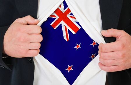 demonstrate: The New Zealand flag painted on the chest of a man Stock Photo